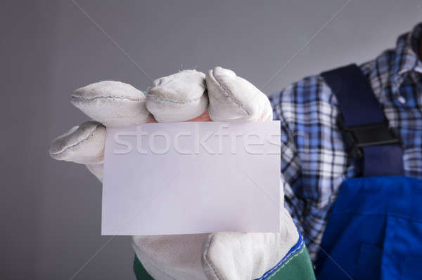 Workman Hands With Gloves Showing Blank Card Stock photo © AndreyPopov