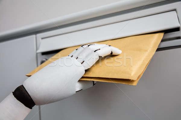 ロボット 封筒 メールボックス クローズアップ ロボットの 手 ストックフォト © AndreyPopov