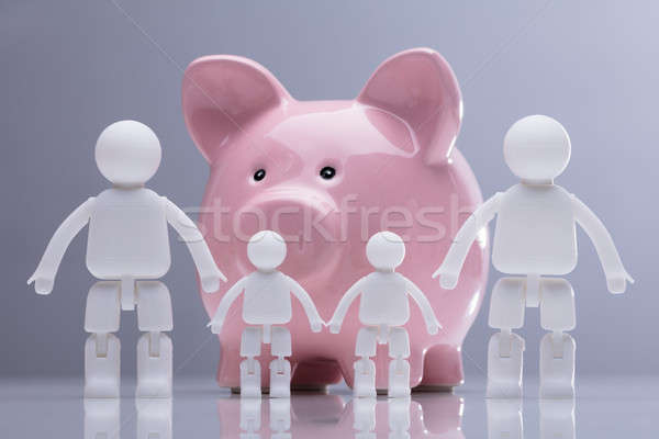Family Human Figures Standing In Front Of Pink Piggy Bank Stock photo © AndreyPopov