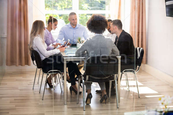 Group Of Businesspeople Sitting In Office Stock photo © AndreyPopov
