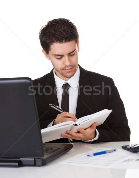 Businessman making a note in his diary Stock photo © AndreyPopov