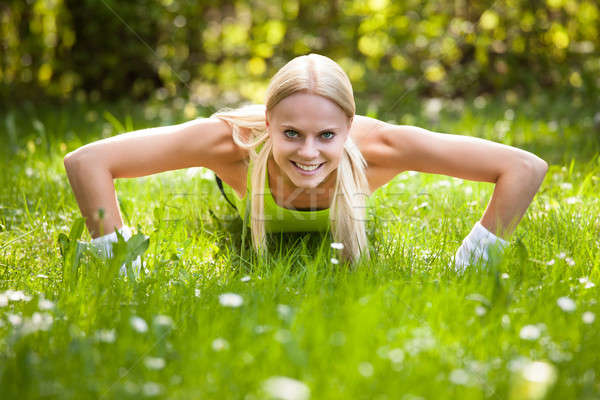 Young Blonde Woman Doing Push Ups Stock photo © AndreyPopov