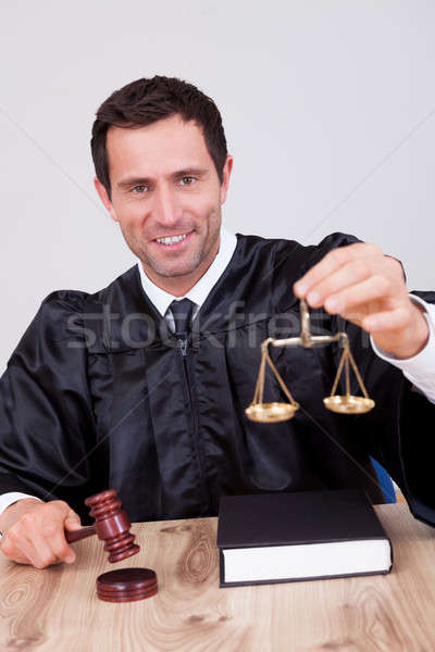 Stock photo: Male Judge Holding Scale