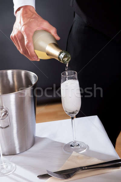 Waiter serving champagne Stock photo © AndreyPopov