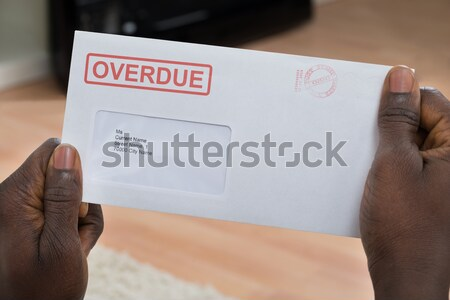 Woman's hand pulling envelop from mailbox Stock photo © AndreyPopov