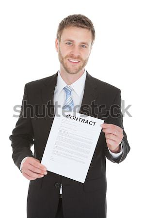 Businessman With Newspaper Stack Stock photo © AndreyPopov