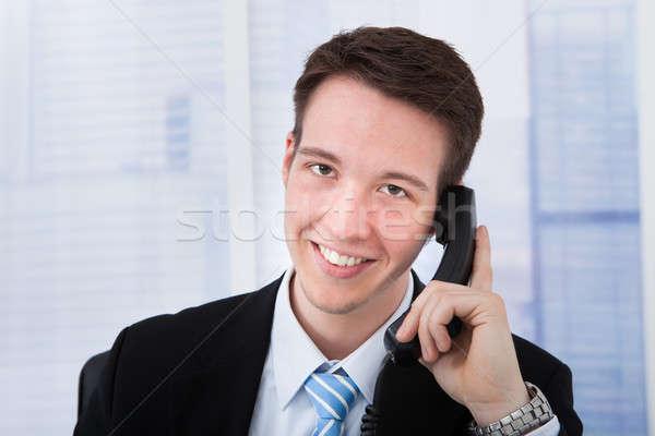 Businessman Using Landline Phone In Office Stock photo © AndreyPopov