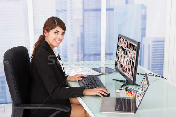Businesswoman Looking At Color Swatches At Desk Stock photo © AndreyPopov