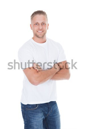 Friendly relaxed young man Stock photo © AndreyPopov