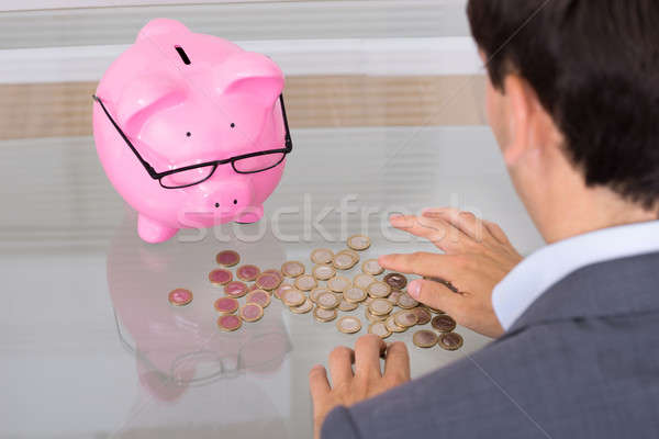 Man counting coins Stock photo © AndreyPopov