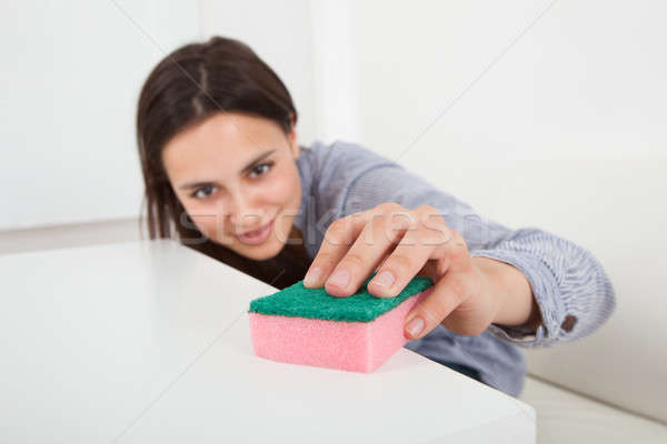 Woman Cleaning Table With Cleanser And Rag In House Stock photo © AndreyPopov