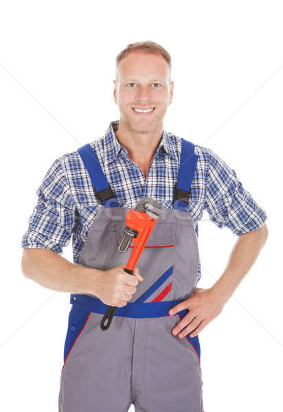 Smiling Handyman Holding Adjustable Wrench Stock photo © AndreyPopov