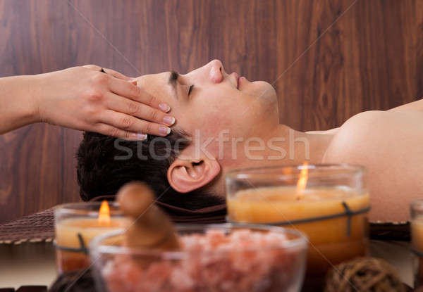 Man Receiving Head Massage From Massager In Spa Stock photo © AndreyPopov