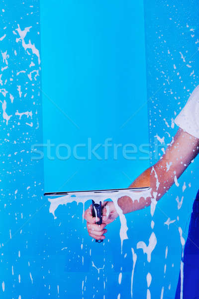Cropped Image Servant Cleaning Glass With Squeegee Stock photo © AndreyPopov