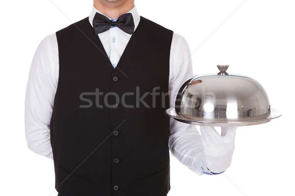 Waiter Holding Metal Cloche Lid Cover On Tray Stock photo © AndreyPopov
