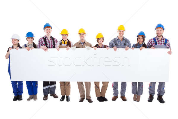 Group of workmen and women with a banner Stock photo © AndreyPopov