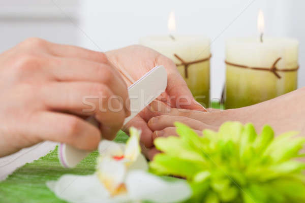 Beautician Filing Nails Of Woman Stock photo © AndreyPopov