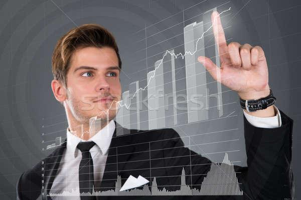 Biznesmen dotknąć przezroczysty ekranu rozwój wykres słupkowy Zdjęcia stock © AndreyPopov