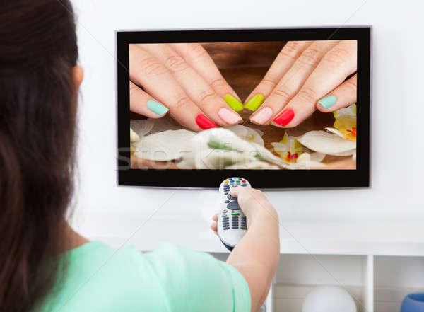 Vrouw televisie kanaal afstandsbediening Stockfoto © AndreyPopov