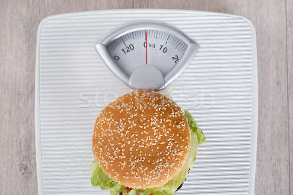 Burger On Weight Scale Stock photo © AndreyPopov