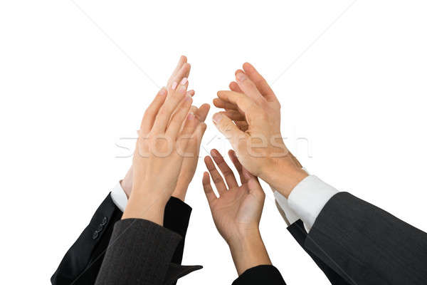 Businesspeople Giving High-five Stock photo © AndreyPopov