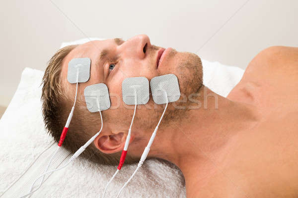 Man With Electrodes On Face Stock photo © AndreyPopov
