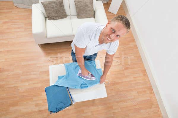 Happy Man Ironing Clothes Stock photo © AndreyPopov