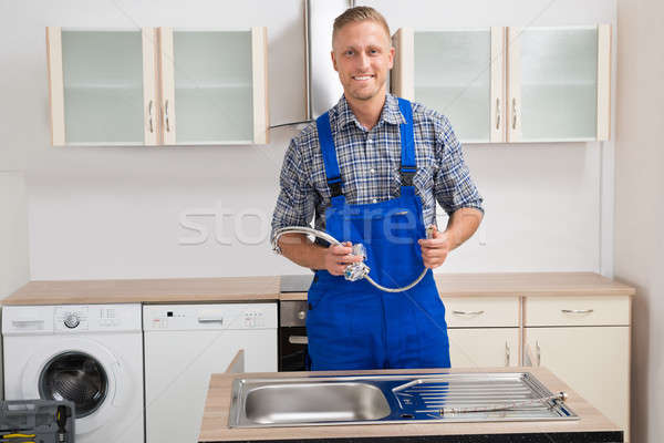 Plumber With Faucet In Kitchen Room Stock photo © AndreyPopov