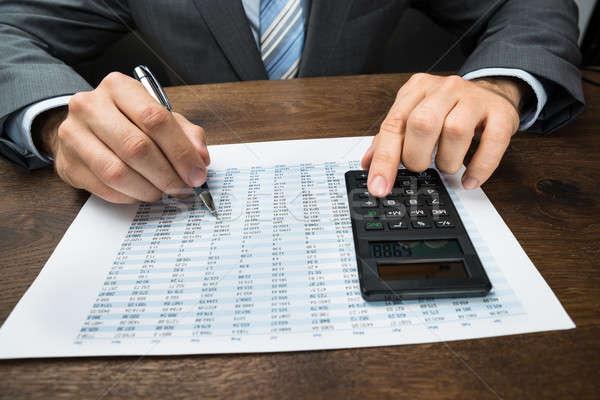 üzletember számítás iroda közelkép számológép üzlet Stock fotó © AndreyPopov