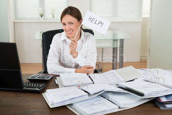Businesswoman With Invoices Asking For Help Stock photo © AndreyPopov