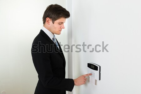 Businessman Entering Code In Security System Stock photo © AndreyPopov