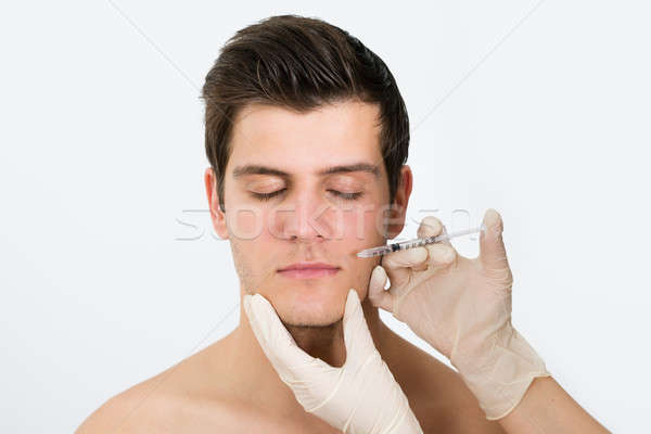 Doctor Hands Injecting Botox Injection In Man Face Stock photo © AndreyPopov
