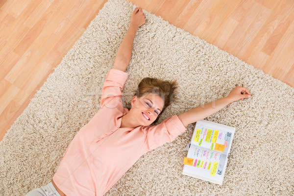 Woman With Diary Lying On Carpet Stock photo © AndreyPopov