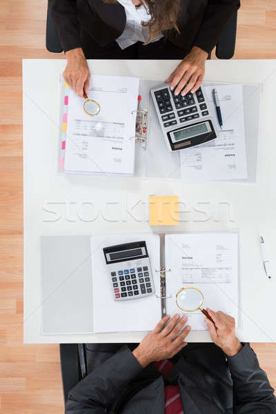 Two Businesspeople Inspecting Financial Expenses Stock photo © AndreyPopov