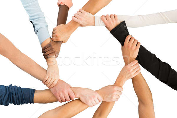 Creative Business People Holding Each Other's Hand Showing Unity Stock photo © AndreyPopov