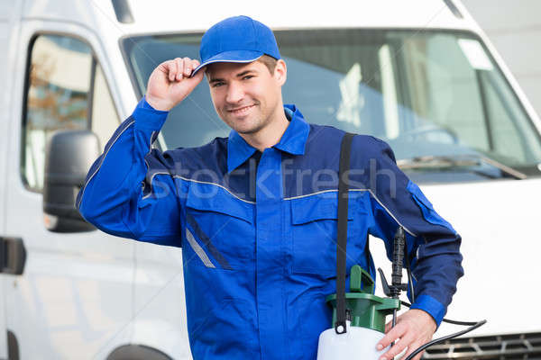 Confident Pest Control Worker Wearing Cap Against Truck Stock photo © AndreyPopov