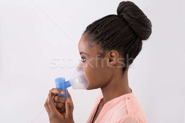 Young Woman Using Oxygen Mask Stock photo © AndreyPopov