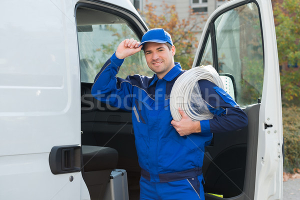 Stock photo: Confident Technician With Cable Coil And Toolbox