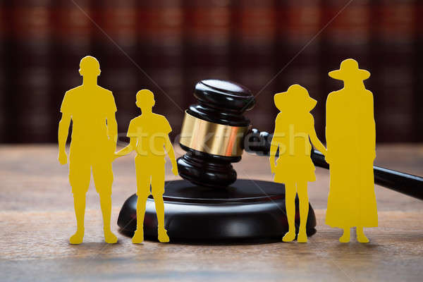 Paper Family With Mallet On Table In Courtroom Stock photo © AndreyPopov