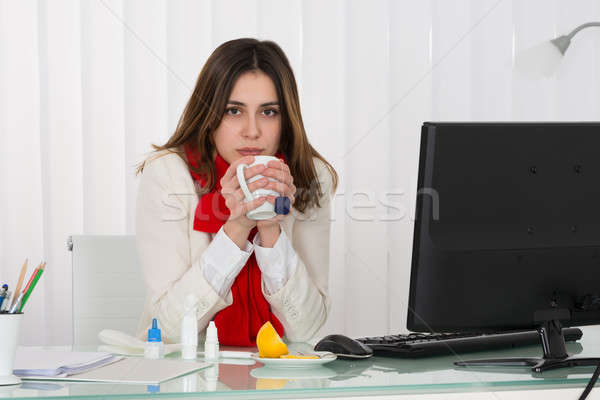 Businesswoman Drinking Cup Of Hot Beverage Stock photo © AndreyPopov