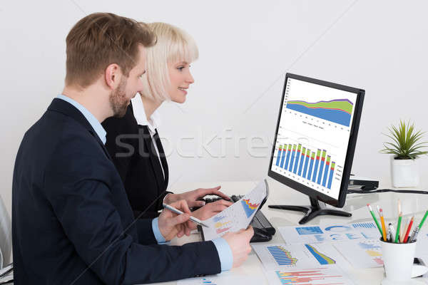 Businesspeople Analyzing Graph On Computer Stock photo © AndreyPopov