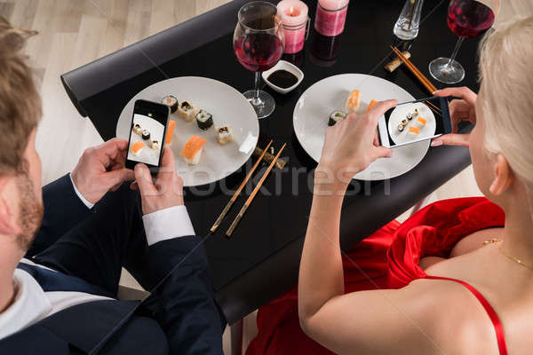 Couple Making Picture Of Food With Their Smartphones Stock photo © AndreyPopov