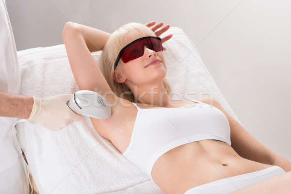 Woman Having Underarm Laser Hair Removal Treatment Stock photo © AndreyPopov