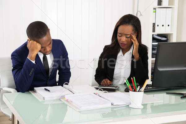 Preocupado escritório dois africano sessão Foto stock © AndreyPopov