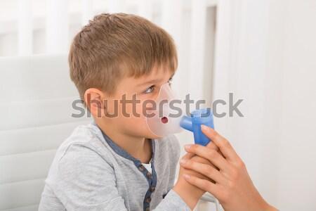 Boy Inhaling Through Oxygen Mask Stock photo © AndreyPopov