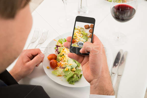 Man Taking Picture Of Food With Mobile Phone Stock photo © AndreyPopov