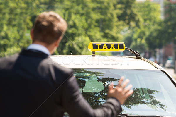 Businessman Calling Taxi Stock photo © AndreyPopov