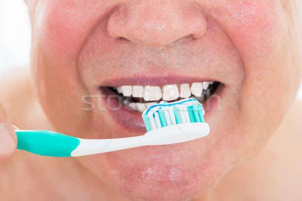 Man Brushing His Teeth Stock photo © AndreyPopov