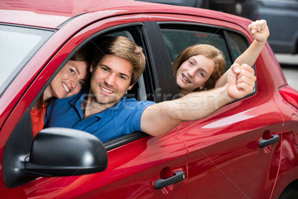 Family Sitting In Car Raising Their Arms Stock photo © AndreyPopov