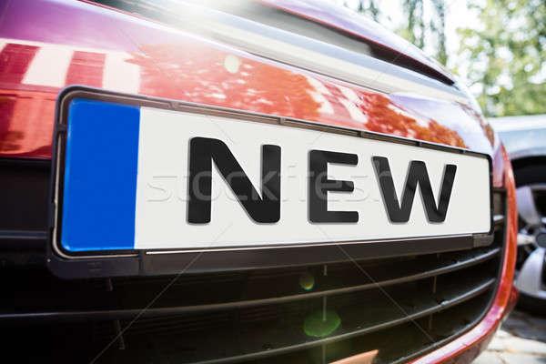 Kentekenplaat auto tonen nieuwe woord Stockfoto © AndreyPopov